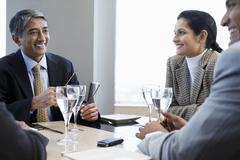 Business People Discussing At Restaurant Table Stock Photos