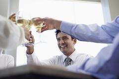 Stock Photo of Businessman With Colleagues Toasting Wineglasses