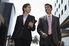 Business People Walking Outdoors - stock photo