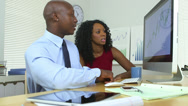 Stock Video Footage of Black business co workers using laptop together
