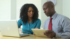 Black business team mates working on laptop and tablet Stock Footage