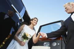 Beautiful Bride Getting Down From Car Stock Photos