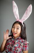 Portrait of sexy asian cowgirl wearing easter's bunny ears Stock Photos