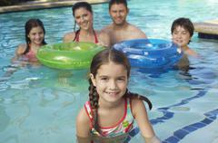 Happy Family In Swimming Pool - stock photo