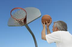 Man Aiming Basketball At Hoop Stock Photos