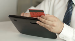 Business man paying credit card in a tablet - stock footage