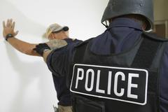 Policeman Arresting Man - stock photo