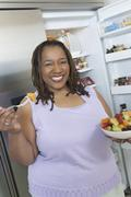 Woman With A Bowl Of Salad - stock photo
