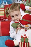 Elementary Boy Holding Stuffed Snowman Stock Photos