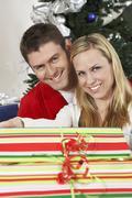 Happy Caucasian Couple With Gift Box - stock photo