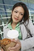 Business Woman On Call Holding Takeout Food - stock photo