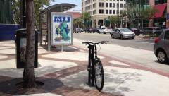 City Bus Stop stand with bike rack & Light Traffic Stock Footage