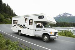 USA, Alaska, Recreational Vehicle Driving On Road Stock Photos