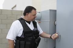 Guard Checking Padlock Stock Photos