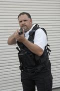 Security Guard In Bulletproof Vest Holding Gun Stock Photos