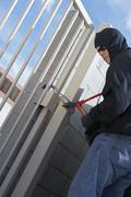 Thief Cutting Lock Stock Photos