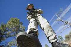 Low Angle Portrait Of Armed Soldier - stock photo