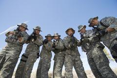 Group Portrait Of Soldiers Aiming Guns - stock photo