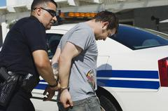 Officer Arresting Drug Dealer - stock photo