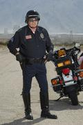 Traffic Cop By Motorcycle Stock Photos