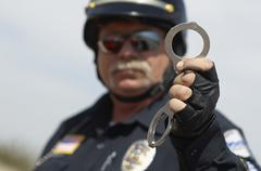 Traffic Cop Holding Handcuffs Stock Photos