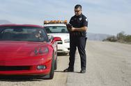 Traffic Cop By Sports Car Stock Photos