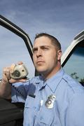 Paramedic Using CB Radio - stock photo
