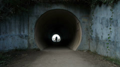 Person Walks Through Tunnel Stock Footage