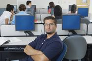 Stock Photo of Confident Male Student In Computer Lab