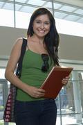 Stock Photo of Beautiful Student Holding Folder