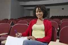 Stock Photo of College Student In Empty Classroom