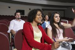 Multiethnic Students Attending Lecture - stock photo