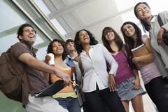 Group Of Students Standing With Professor - stock photo