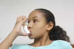 Girl Using Asthma Inhaler - stock photo