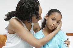 Woman Comforting Sick Daughter Stock Photos