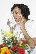 Woman With Allergy Holding Tissue Near Flowers Stock Photos