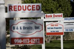 Real Estate Signs at Foreclosed Property - stock photo