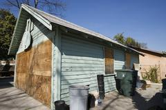 Boarded Up Garage of Empty House - stock photo