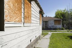 Abandoned Houses With Boarded Up Windows - stock photo