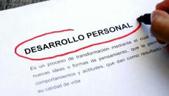 Circling Personal Development with a pen (In Spanish) Stock Footage