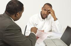 Financial Advisor In Discussion With Tensed Businessman - stock photo