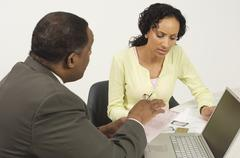 Financial Advisor In Discussion With Woman - stock photo