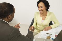 Stock Photo of Woman Shaking Hands With Financial Advisor