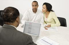 Couple Discussing Financial Plans With Male Advisor Stock Photos