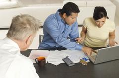 Couple With Senior Financial Advisor - stock photo