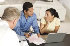 Couple In Meeting With Advisor Stock Photos