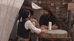 People at the table in historical, traditional costumes. Bozner Markt. Stock Footage