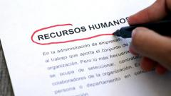 Circling Human Resources with a pen (In Spanish) Stock Footage