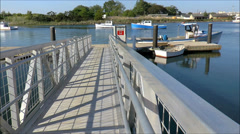 Foot Bridge to river boat dock Stock Footage