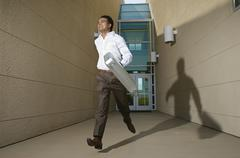 An Indian Businessman Running - stock photo